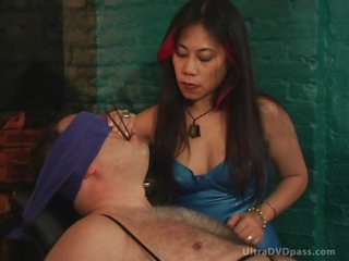 Mature Asian Mastix Sits Submissive Male on the Bondage Chair