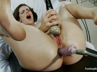 Slutty nympho couldn't help groaning as she receives team-fucked by a fucking machine