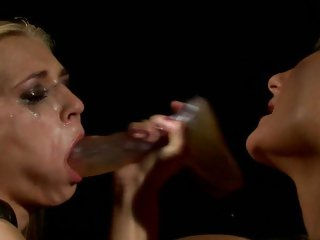 Katy Borman shoves a dildo down Linda Ray's face hole