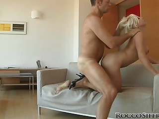 Bibi Fox strips out of her snow white dress and then takes Rocco's pulsating cock from behind. She fucks this blonde like there's no tomorrow. Doggystyle is the only position for Bibi Fox.