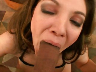 Alluring Kiki Daire slurps on this throbbing prick