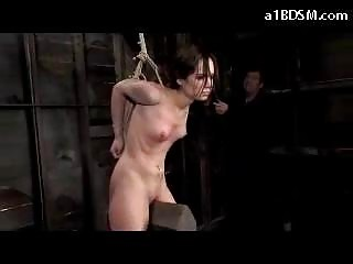 Slim Girl With Tied Arms Tortured With Clips Whipped In The Dungeon