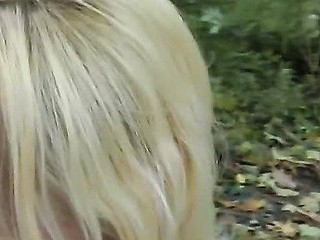 Blond beauty gives oral job in the park