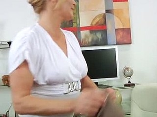 Breasty golden-haired secretary uses a magic wand to masturbate on break