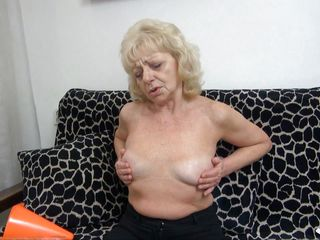 blonde granny masturbates on the couch