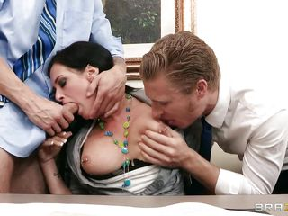 lustfull brunette stuffing her mouth with two cocks