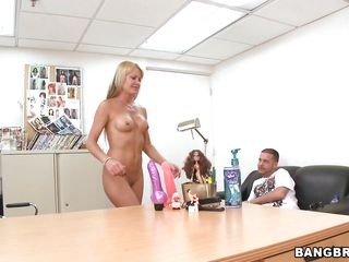 blonde milf taunting a guy before sucking him