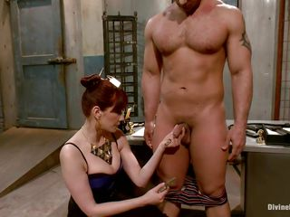 redhead mistress exploits her muscled guy