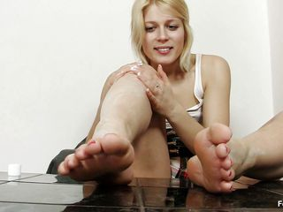 cute blonde milf playing with her feet