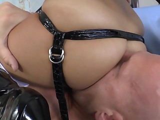 A bitch with a strap on teases and fucks her male partner