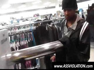 Concupiscent twink gets on his knees and sucks black schlong in a store