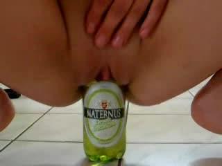 Amateur bonks a beer bottle in kitchen