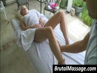 Sexy golden-haired babe gets a sexy oil massage on her hot young body